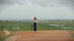Young woman in countryside patio observing beautiful scenic view. Stock Footage