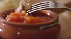 Eating a piece of meat with sauce closeup of the restaurant Stock Footage