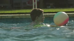 Child swimming inside the pool during summer holidays Stock Footage
