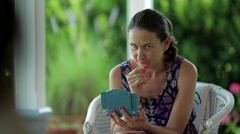 Woman thinking about what move to do next in battleship game. Stock Footage