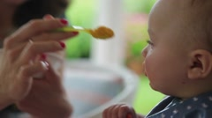 Mom feeding baby. Close up of a baby being fed by his mother. Stock Footage