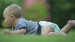 Baby crawling forward. Baby's legs in outdoors Stock Footage