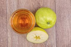 Apples and juice on a wooden background - stock photo
