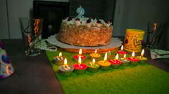 Candles for a happy birthday party are burning - stock footage