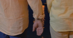 Close-up of man and woman holding hands at sea Stock Footage