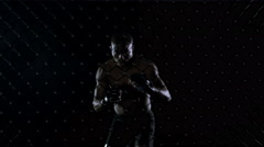 4K MMA fighter throwing kicks & punches in the fighting cage. Shot on RED Epic. - stock footage