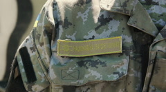 Closeup of Ukrainian National Guard officer with stripe on jacket - stock footage