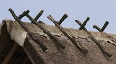 Animal skin on thatched roof + zoom out reconstructed celtic home Stock Footage