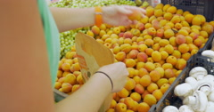 Picking Apricots from the Fruit Pack Stock Footage