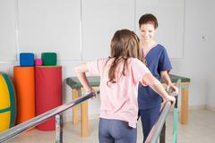 Physical therapist with patient in rehabilitation Kuvituskuvat