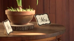 Light shimmering on a wedding table setting with mr and mrs signs Stock Footage