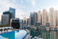 Stock Photo of Dubai city seafront with hotel infinity edge pool