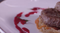 Food in slow motion cutlets on a plate and berry sauce Stock Footage