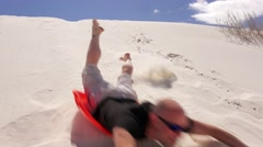 Man Slides Down Sand Dune at White Sands National Monument in New Mexico Stock Footage