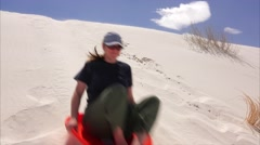 Woman Slides Down Sand Dune at White Sands National Monument in New Mexico Stock Footage