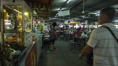Time lapse of people passing by in chinese hawker stall - stock footage