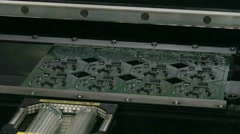 Unit collects electronic circuit Board in 4K. Stock Footage