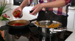 Girl is preparing spaghetti bolognese. Close up. Stock Footage