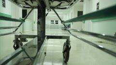 Gurney being pushed down an empty hospital hallway into Restricted area HD video Stock Footage