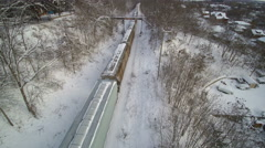 Drone: Track Forward over a Freight Train in the Snow Stock Footage