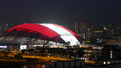 National stadium in Singapore at night seen from a skyscraper Stock Footage