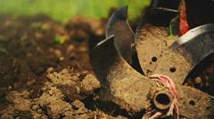 Man preparing garden soil with cultivator tiller - stock footage