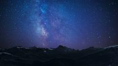 night sky stars milkyway on mountains background - stock footage