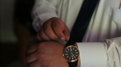 Man putting on wrist watch. Isoalted on black background, shallow focus Stock Footage