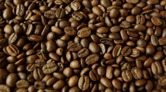 Rotation of aromatic roasted coffee beans Stock Footage
