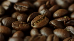 Macro rotation of aromatic roasted coffee beans Stock Footage