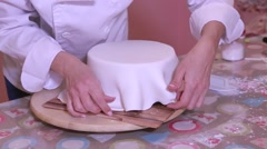 Preparation of a fondant cake, sponge cake, chocolate and sugar for a celebra Stock Footage