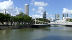 Singapore river with the Cavenagh Bridge and Mansion Bay Stock Footage