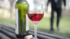 Young Man takes a glass of red wine on the street of an old Europe town - stock footage