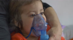 Child Doing Nebulizer Teraphy - stock footage