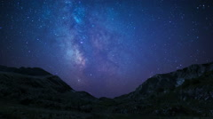 Night sky stars milkyway on mountains background Stock Footage