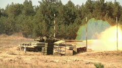 Russian heavy tank firing on field at sunny day Stock Footage
