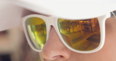 Close-up of woman wearing mirrored sunglasses - stock footage