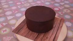 Brown chocolate fondant cake rotating Stock Footage