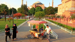 Corn vendor in front of Hagia Sophia in Holy Month of Ramadan - stock footage