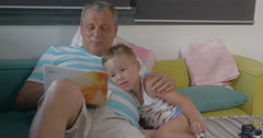 Grandfather and grandchild with laptop at home - stock footage