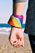 Man with a rainbow-patterned kerchief in his wrist Stock Photos