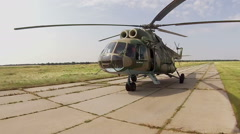 Military cargo helicopter on runway with working engines - stock footage