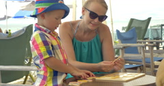 Child learning numerals playing with mom outdoor - stock footage