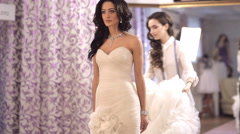 The consultant helped the future bride to choose wedding dress Stock Footage
