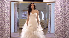 The consultant helped the future bride to choose wedding dress - stock footage