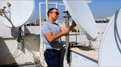 Fixing television satellite antenna on the supporting structure Stock Footage