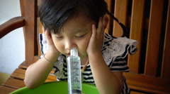 A little asian girl nasal irrigation, 4K - stock footage