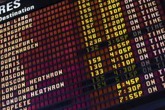 Airport arrival and departure schedule board - stock photo