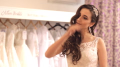 Girl happy to selected wedding dress Stock Footage