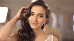 Girl admires selected wedding dress Stock Footage